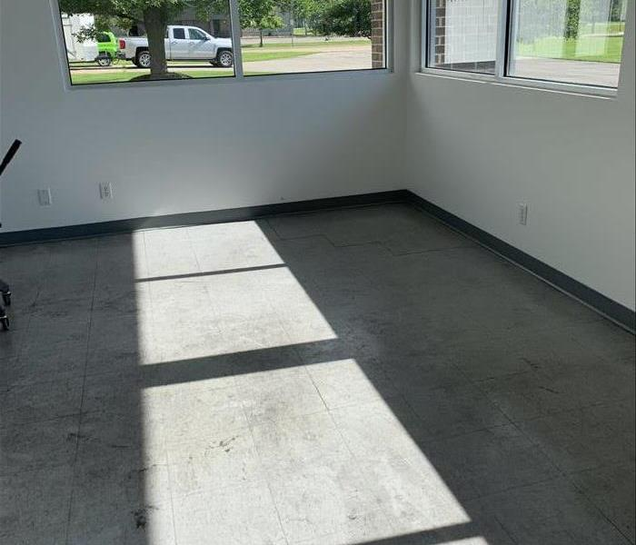 Commercial tile floor is dirty from lots of traffic