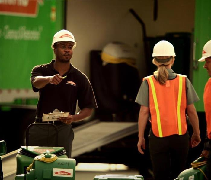 SERVPRO workers with helmets